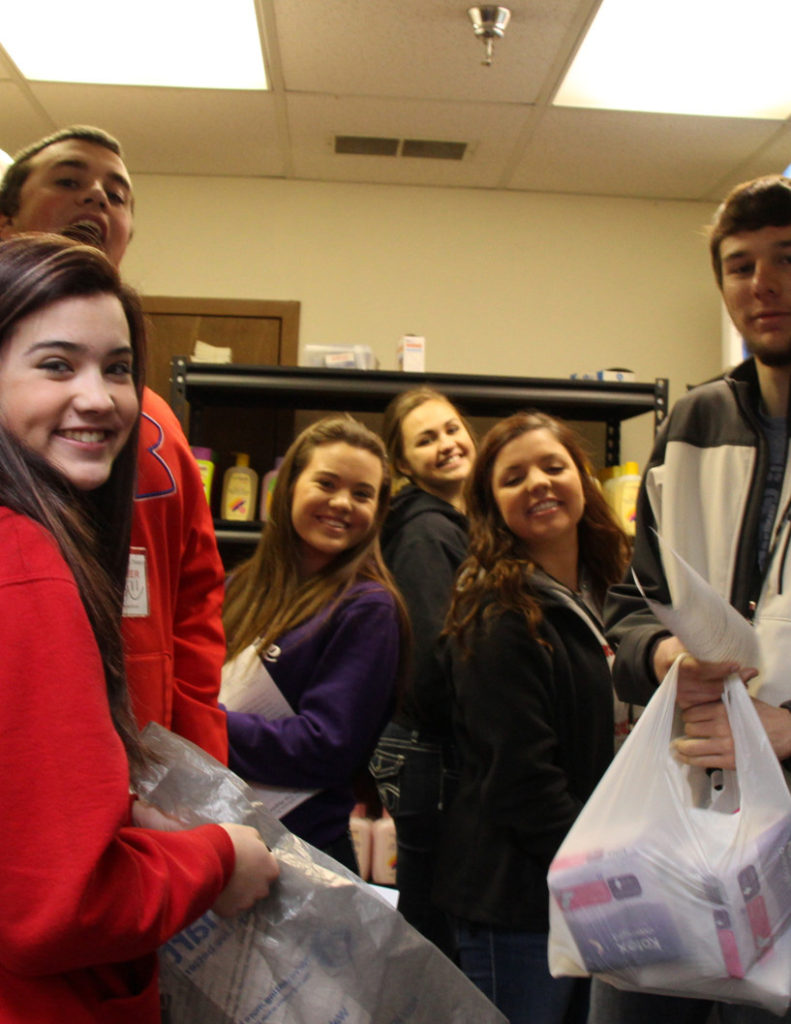Rose Hill Students helping prepare for the Head to Toe Hygiene Pantry distribution